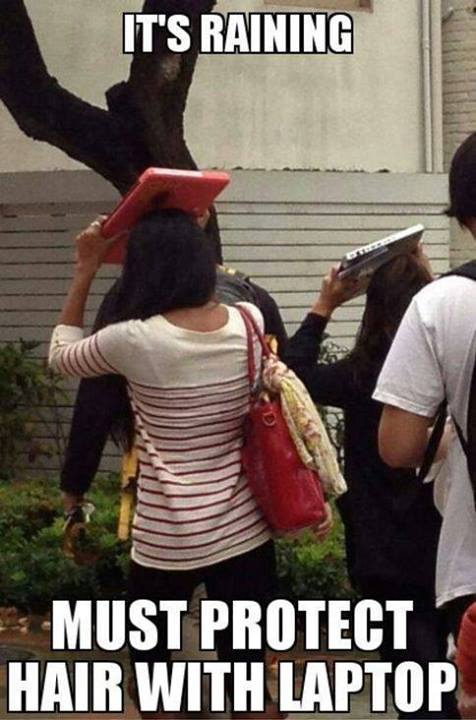 Its raining must protect hair with laptop