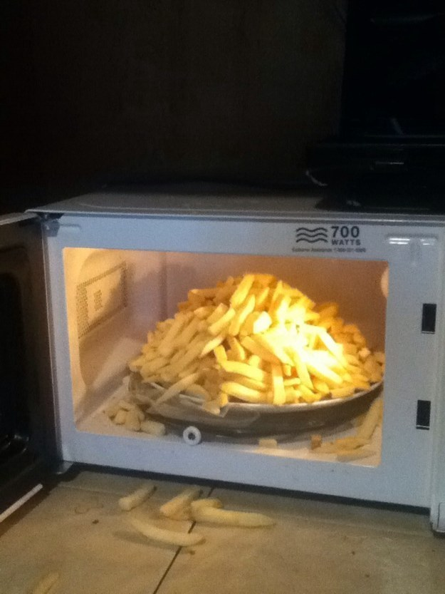 Microwaving a mountain of french fries.