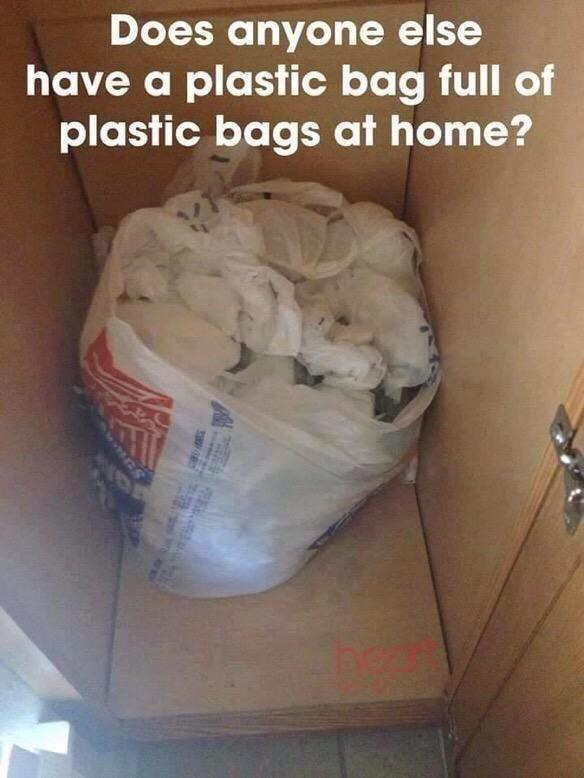 A cabinet full of plastic bags